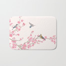 Birds and cherry blossoms Bath Mat