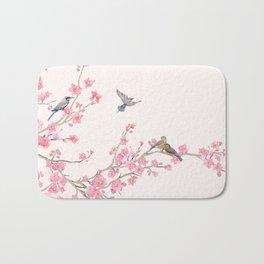 Birds and cherry blossoms Bath Mat