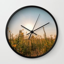 Uncultivated field in the Lomellina countryside at sunset full of yellow flowers Wall Clock