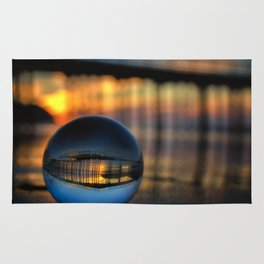 Avila Pier Captured in a crystal ball at sunrise Rug