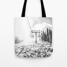 Powder on the Hill // Black and White Skilift Shot on a Deep Snowday Tote Bag