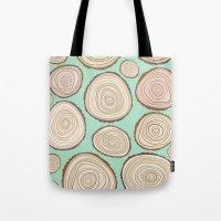 tree rings Tote Bags featuring Tree Rings by Jackie Sullivan
