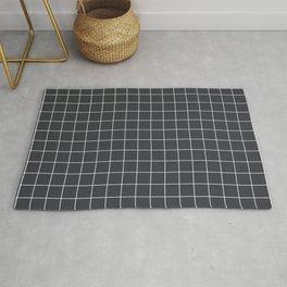 Minimal grid pattern on dark lava Rug