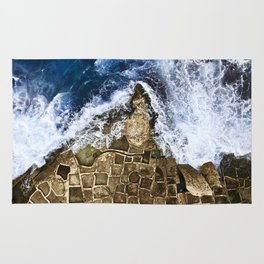 An abstract of the ocean and the coastal rocks. Rug