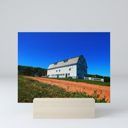 Barn and Red Sands under Blue Skies Mini Art Print