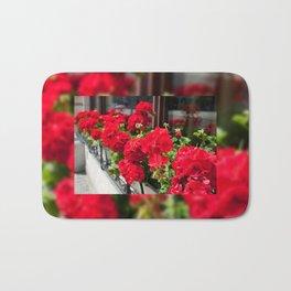 Bunches of vibrant red Pelargonium Bath Mat