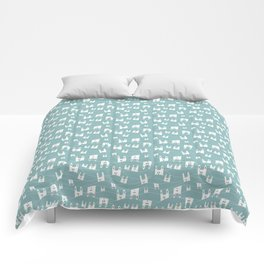 White bunnies on blue background Comforters