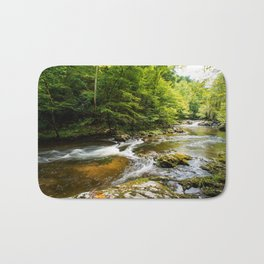 River surrounded by trees and plants Bath Mat