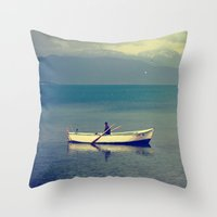 rowing Throw Pillows featuring rowing a boat in egirdir lake by gzm_guvenc