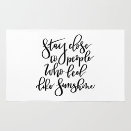 Stay close to people who feel like sunshine black lettering Rug
