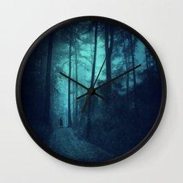 Light in a cyan forest Wall Clock
