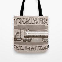 pocket fuel Tote Bags featuring Rockatansky Fuel Haulage by Doodle Dojo