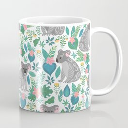 Cute gray koalas with ornaments, tropical flowers and leaves. Seamless tropical pattern. Coffee Mug