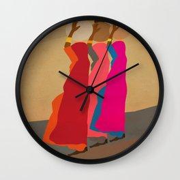 Three women carrying water 1 Wall Clock