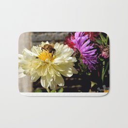 Close-up of a Busy Bee on a Butter White Flower Bath Mat