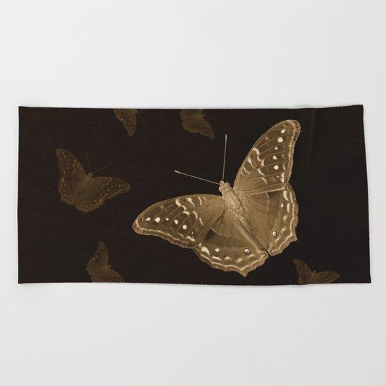Butterflies in the dark Beach Towel