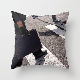 Group of businessmen and women walk along crosswalk in Shinjuku, Tokyo, Japan Throw Pillow