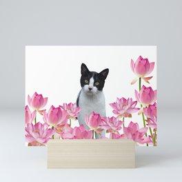 Black and white Cat sitting between Lotos Flowers Mini Art Print