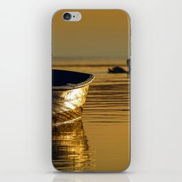 Rowing boat and swan sunset reflections iPhone Skin