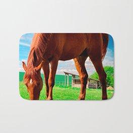 horse eating grass Bath Mat