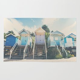 beach huts photograph Rug