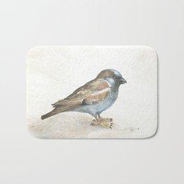 His eye is on the sparrow Bath Mat