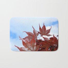 red leaf sky Bath Mat