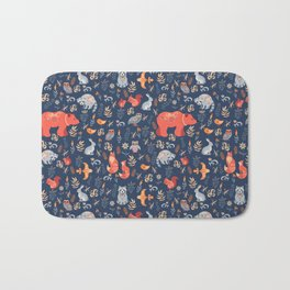 Fairy-tale forest. Fox, bear, raccoon, owls, rabbits, flowers and herbs on a blue background. Seamle Bath Mat