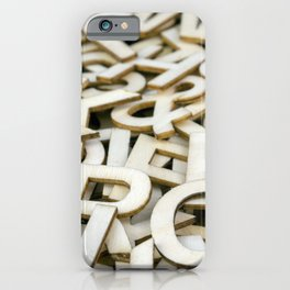 Pile of Mixed Wooden Letters Close Up iPhone Case