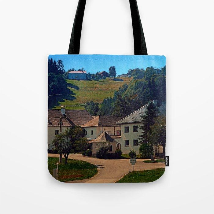 Small village in autumn scenery Tote Bag