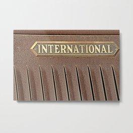 International emblem on an old truck rusting in a field Metal Print
