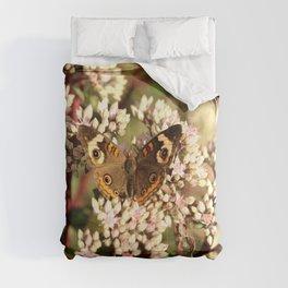 Buckeye Butterfly On Pale Pink Flowers Comforters