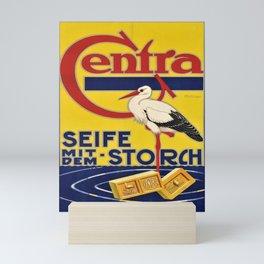 old placard centra seife mit dem storch Mini Art Print