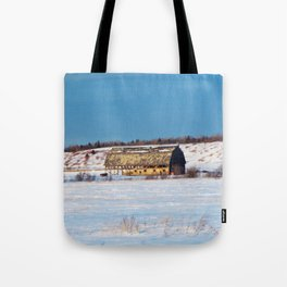 Barn gets a little glow from the Sun as it sits, waiting to be torn apart. Tote Bag
