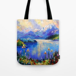Flowers on the shore of a mountain lake Tote Bag