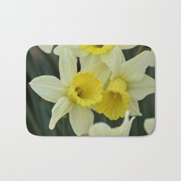 daffodils bloom in spring in the garden Bath Mat