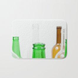 Empty bottles arranged on white backgorund Bath Mat