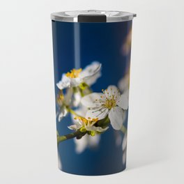 Beautiful White Jasmine Flowers With Green Leaves Against A Blue Background Travel Mug