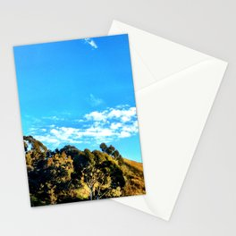 Trees and clouds in the sky. Stationery Cards