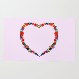 heart made of flowers on a pink background . Artwork Rug