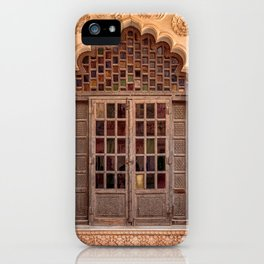 Wooden stained glass door at Jodhpur Fort, India iPhone Case