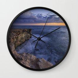 Sunset on island's coast Wall Clock