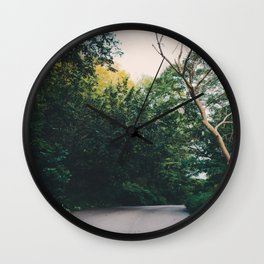 Journey through a forest road Wall Clock