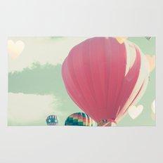 Hot air balloon nursery and heart bokeh on pale blue Rug