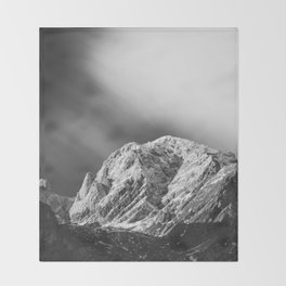 Misty clouds over the mountains in black and white Throw Blanket