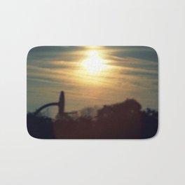 sun sets over a school yard Bath Mat