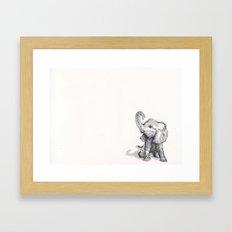 tiny elephant sitting in the corner Framed Art Print
