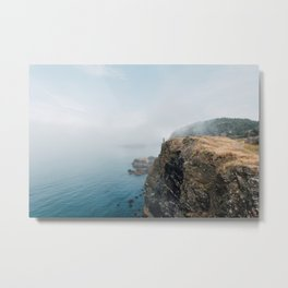 Woman on a cliff Metal Print
