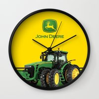 john green Wall Clocks featuring John Deere Green Tractor by rumahcreative