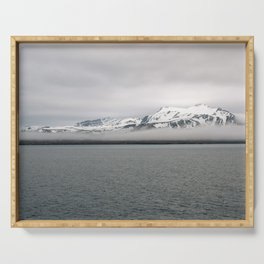 Fog between Arctic Ocean and glacier mountains Serving Tray